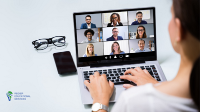 woman typing on laptop with 9 people on video conference who may have Zoom Fatigue